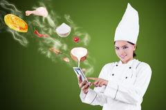 Female Chef Searching Recipe Online Stock Images
