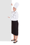 Female Chef Showing Blank Placard Royalty Free Stock Photos