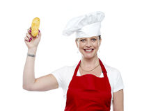 Female chef showing bread before baking it Royalty Free Stock Photos