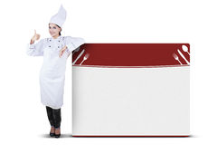 Female Chef Showing Perfect Hand Sign Royalty Free Stock Photography