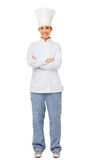 Female Chef Standing Arms Crossed. Full length portrait of happy female chef standing arms crossed isolated on white background. Vertical shot stock image