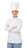 Female Chef Standing Arms Crossed. Portrait of young female chef standing arms crossed over white background. Vertical shot stock photo