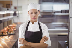 Female chef standing in the commercial kitchen. Portrait of female chef standing in the commercial kitchen royalty free stock images