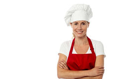 Female chef standing with her arms crossed Stock Photography