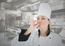 Female chef tasting food in kitchen Stock Image