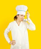 Female chef tasting from ladle Royalty Free Stock Photos