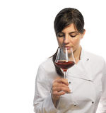 Female chef tasting red wine Royalty Free Stock Photos