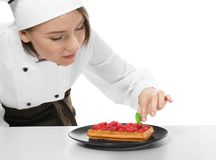 Female chef with tasty dessert. On white background royalty free stock photo