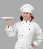 Female chef with a tray. Royalty Free Stock Photo