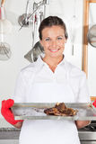 Female Chef With Tray Of Meat Royalty Free Stock Photo