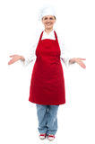 Female chef welcoming you with a smile Royalty Free Stock Images