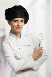 Female chef with whisk Stock Images