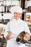 Female Chef With Wire Whisk And Mixing Bowl Royalty Free Stock Photography