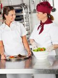 Female Chefs With Their Dishes In Kitchen Stock Photos