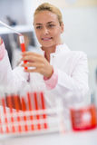 Female chemical technician full test tube with sample liquid Stock Photography