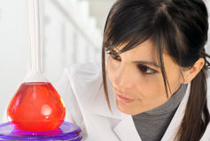 Female chemist with flask Stock Photos