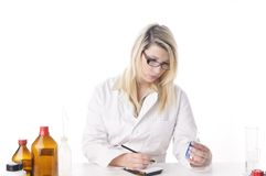 Female chemist makes notes Royalty Free Stock Image