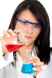 Female chemist mixing liquids Royalty Free Stock Photography