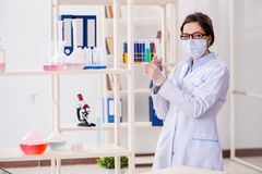 The female chemist working in hospital lab. Female chemist working in hospital lab Royalty Free Stock Photos