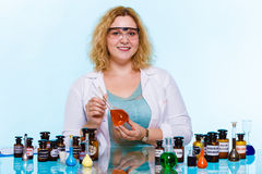 Female chemistry student with glassware test flask. Royalty Free Stock Photography