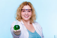 Female chemistry student with glassware test flask. Stock Images