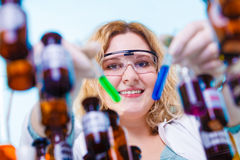 Female chemistry student with glassware test flask. Royalty Free Stock Photos
