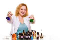 Female chemistry student with glassware test flask. Royalty Free Stock Images