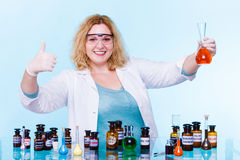 Female chemistry student with glassware test flask. Stock Photos