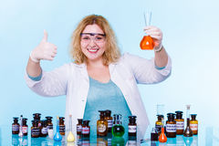 Female chemistry student with glassware test flask. Royalty Free Stock Photo