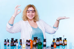 Female chemistry student with test flask open palm Royalty Free Stock Images
