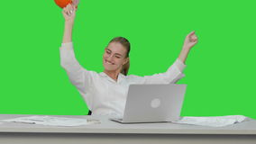 Female chief engineer celebrate a successful finish of project, smiling on a Green Screen, Chroma Key. 076. You can use it e.g. in your commercial video stock video