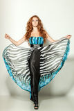 Female in chiffon dress. Full length of a beautiful red-haired fashion model posing Royalty Free Stock Images