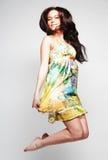 Female in chiffon dress jumping Stock Photography