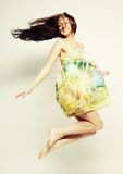 Female in chiffon dress jumping Royalty Free Stock Photos