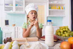Female child is excited of baking Royalty Free Stock Images