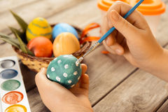 Female child paints Easter egg Stock Photography