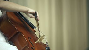 Female child playing the cello.  stock video footage