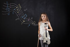 Female child playing the violin Stock Image
