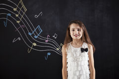 Female child playing who loves music Royalty Free Stock Images