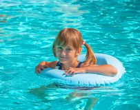Female child in the pool Royalty Free Stock Image