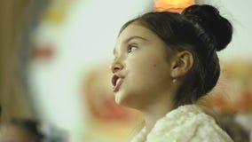 Female child singing in the choir. Model Elizabeth Andreeva stock video footage
