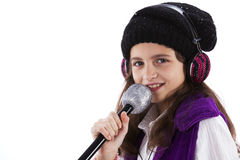 Female child singing. With a mic and headphones Stock Image