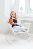 Female child sitting in her room Royalty Free Stock Photos