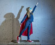 Female child 7 or 8 years old young girl performing happy and excited posing wearing cap and mask in super hero fantasy costume lo. Oking playful in studio stock photos