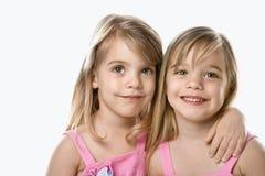 Female children twins. Portrait of female caucasian twins royalty free stock photos