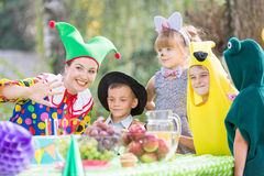 Female and children wearing costumes Stock Image