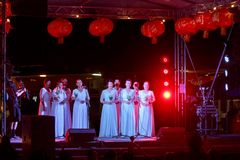 Female Chinese singers in white dresses, Chinese New Year royalty free stock images