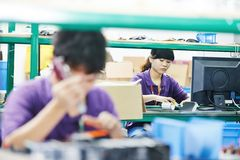 Female chinese worker in factory royalty free stock images