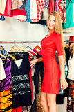 Female choice. Fashionable girl shopping in a store Royalty Free Stock Images