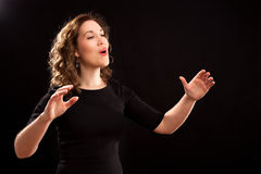 Female choir conductor Stock Photo